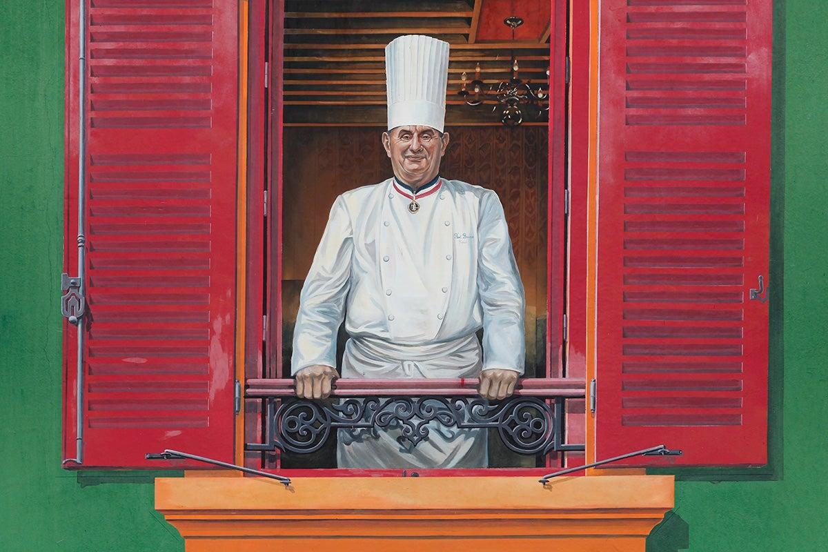 Retrato del cocinero dibujado en la fachada de su restaurante. Foto: Shutterstock.